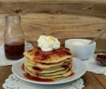 Leftover Cranbery Sauce Pancakes with Orange Whipped Cream | www.whiskeyandchanel.com