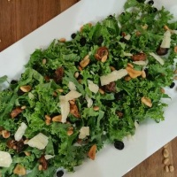 Leopold's Kale Salad with Currants and Pine Nuts